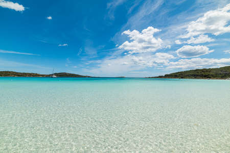 cala brandinchi under a bue sky with clouds, Sardinia Stock Photo