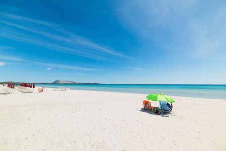 man alone in La Cinta beach, Sardinia