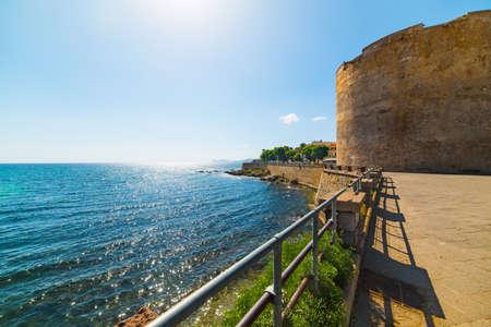 skim: historic tower in Alghero seafront, Sardinia Editorial