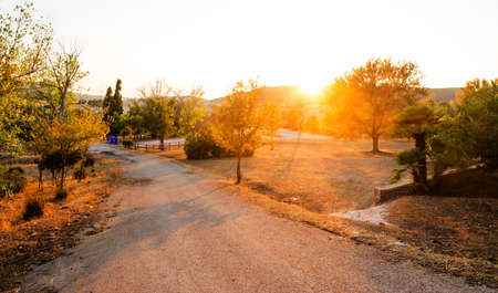 end of a long day: country road at sunset, Sardinia Stock Photo
