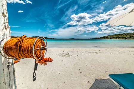 orange rope by the shore in Sardinia, Italy