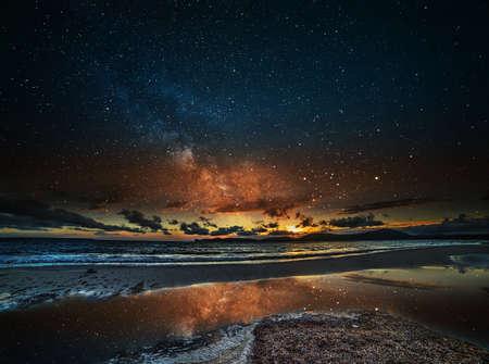 starry night: starry sky over Alghero at night, Sardinia Stock Photo