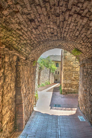 medieval underpass in San Gimignano, Italy