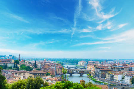 Arno river in Florence on a clear day, Italy