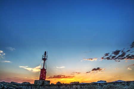 red lighthouse in Alghero harbor, Sardinia