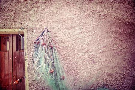 planck: fisherman net hanging on a rustic wall