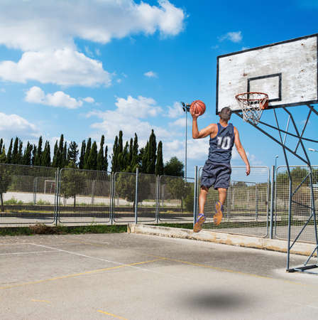 slam dunk in a basketball playground Stock Photo