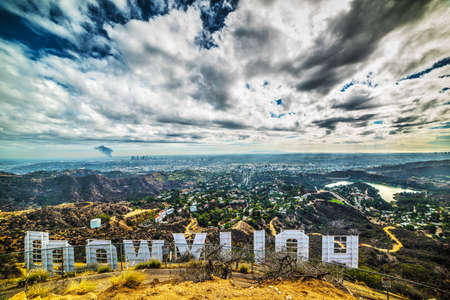 Hollywood sign seen from behind under a dramatic sky