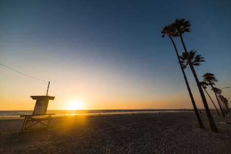 lifeguard tower and palm trees in Newport beach, California Stock Photo