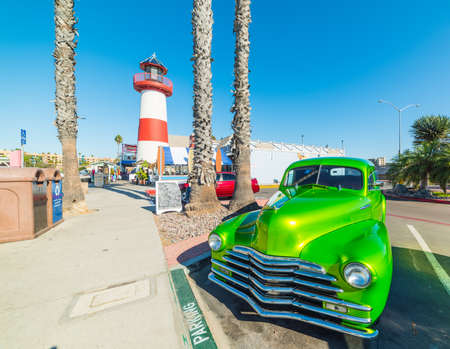 Classic car by Oceanside lighthouse, California Stock Photo