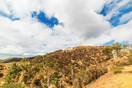 LOS ANGELES, CALIFORNIA - OCTOBER 27, 2016: Hollywood sign under a blue sky with clouds, California Editorial