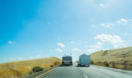 18 wheeler: Truck overtaking a caravan in Interstate 5, California