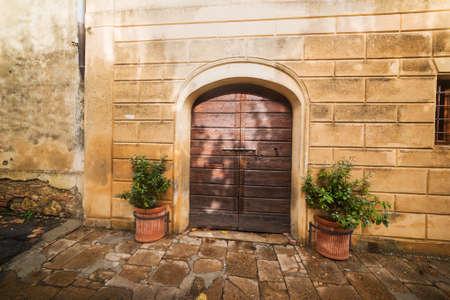 montepulciano: detail of a wooden door in Montepulciano, Italy