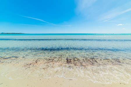 Cirrus clouds in La Cinta beach, Sardinia Stock Photo