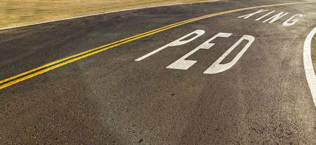 xing: Ped Xing written on the road in California Stock Photo