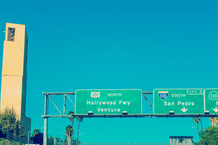 Hollywood freeway sign by Cathedral of Our Lady of Angels steeple, California Stock Photo