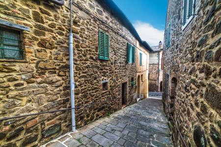 Narrow street in Tuscany, Italy Editorial
