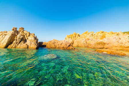 shorelines: Rocks and turquoise water in Sardinia, Italy