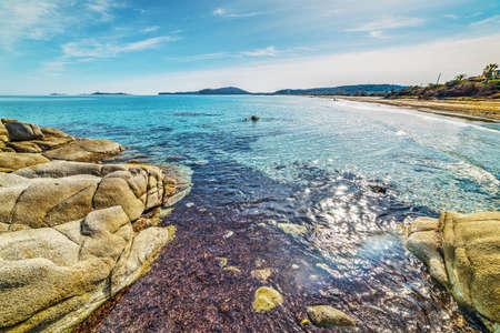 Rocks and seaweeds in Simius beach, Sardinia