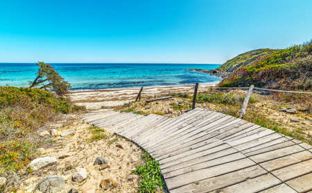 Wooden boardwalk in Scoglio di Peppino beach, Sardinia