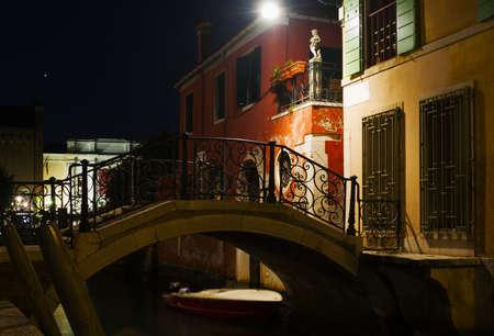 popular: Small bridge in Venice at night. Italy Stock Photo