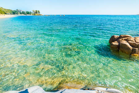 Turquoise water in Santa Maria Navarrese beach. Sardinia, Italy Stock Photo