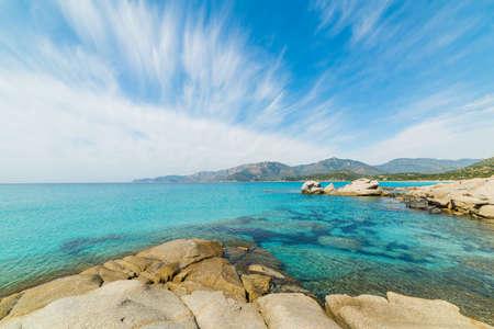 cirrus: Cirrus clouds over Spiaggia del Riso. Sardinia, Italy
