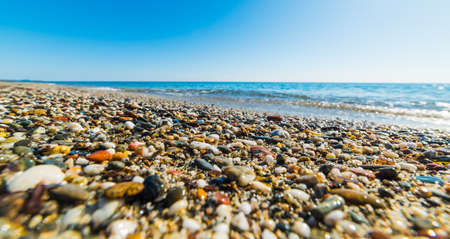 waves  pebble: Pebbles by the sea in Perdepera beach. Stock Photo