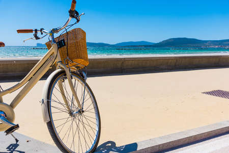 Bicycle parked by the sea. Stock Photo
