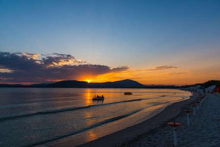 Colorful sunset in Alghero shore. Sardinia, Italy Stock Photo