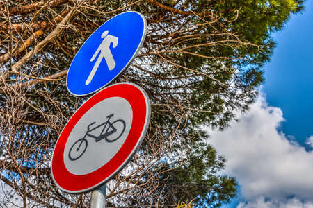 Bike and pedestrian signs in springtime. Sardinia, Italy
