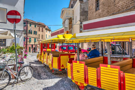 Tourists in Alghero old town. Sardinia, Italy 版權商用圖片