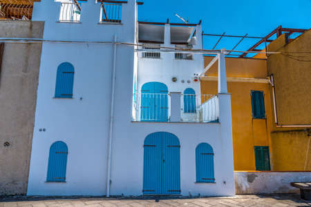 bastion: Colorful houses in Alghero seafront. Sardinia, Italy