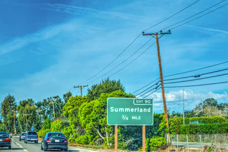 Summerland exits sign on 101 freeway northbound. California, USA