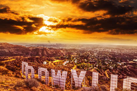 Los Angeles, CA, USA - October 28,2016: Colorful sky over Hollywood sign Фото со стока