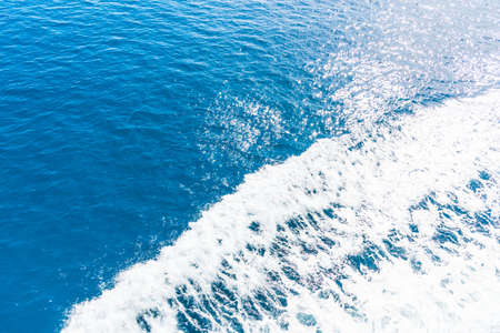 pitching: Boat trail in the blue sea. Sardinia, Italy Stock Photo