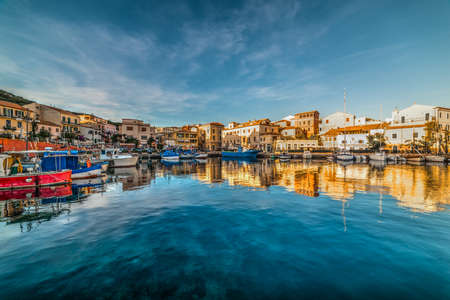 Reflections in La Maddalena harbor at sunset. Sardinia, Italy 스톡 콘텐츠