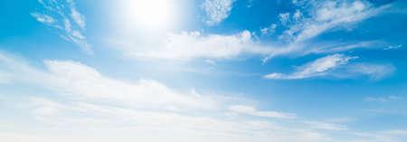 Sun shining amongs white clouds