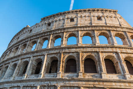 World famous Coliseum under a blue sky. Rome, Italy Stock Photo