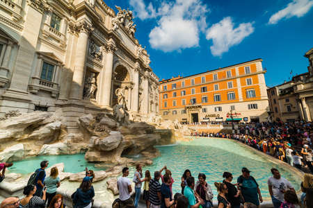 Rome, Italy - October 13, 2017: Tourists by world famous Fontana di Trevi Editorial