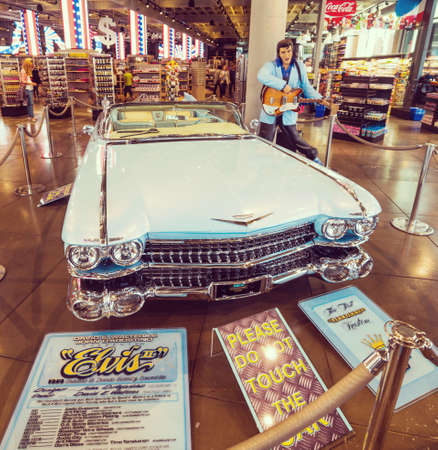 Los Angeles, CA, USA - November 02, 2017: Elvis Presley statue and vintage Cadillac in a souvenir store in Hollywood boulevard