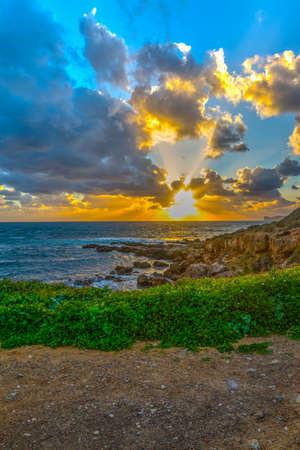 Dramatic sky over the sea at sunset. Sardinia, Italy Stock Photo