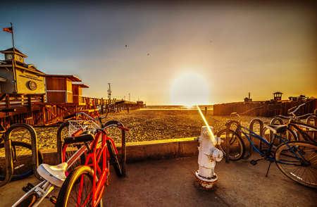 Bikes in Newport Beach at sunset. Los Angeles, California