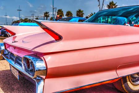 Alghero, Italy - April 08, 2018: Classic pink Cadillac at American Motor Festival 2018