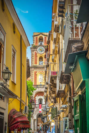 Narrow street with Duomo steeple in old town Sorrento
