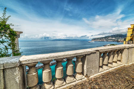 Concrete balustrade by the shore in world famous Sorrento. Campania, Italy