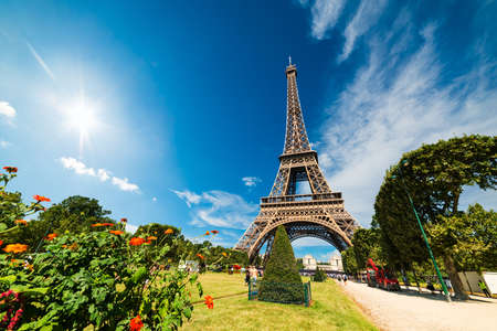 Sun shining over world famous Eiffel tower in Paris, France