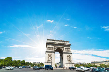 Sun shining over world famous Triumphal arch in Paris, France 스톡 콘텐츠