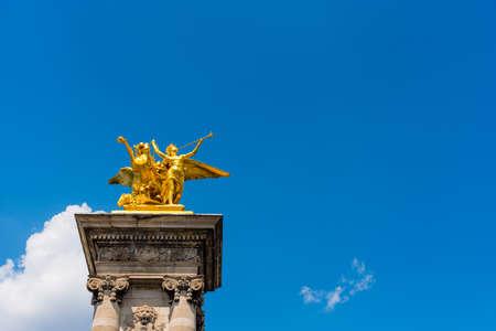 Front view of Pegasus golden statue on Alexander III bridge in Paris, France