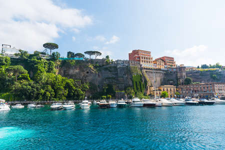 Boats in Sorrento harbor on a sunny day. Amalfi coast, Italy Banque d'images - 114630038